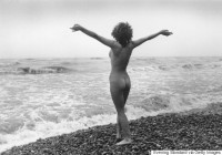 circa 1980:  A nudist surveys the sea on the Brighton sea front.  (Photo by Evening Standard/Getty Images)